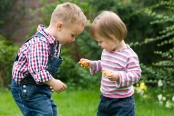 Both 3- and 5-year olds shared more when they were obligated to share than when it was voluntary. However, such obligated sharing did not make them happy.