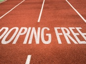 "Image of sports track with ""doping free"" in writing: First-of-its-kind study asked top cyclists and field athletes to rank effectiveness of different sport anti-doping strategies: Frontiers in Psychology"