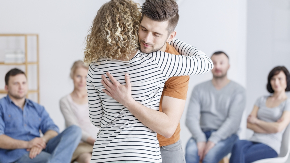 Image of young people hugging during a rehabilitation session