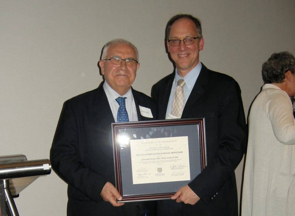 Image of Professor Giovanni Meola receiving his award of Distinguished International Professor during the annual meeting of the American Academy of Neurology