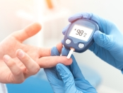 Doctor checking blood sugar level with glucometer. Treatment of diabetes concept.