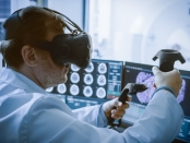 Futuristic Concept: In Medical Laboratory Surgeon Wearing Virtual Reality Headset Uses Controllers to Remotely Operate Patient with Medical Robot. High-Tech Advancements in Medicine.