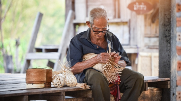 Asia life old man uncle grandfather working in home / Man elderly serious living in the countryside of life rural people in thailand weaving bamboo making basket crafts