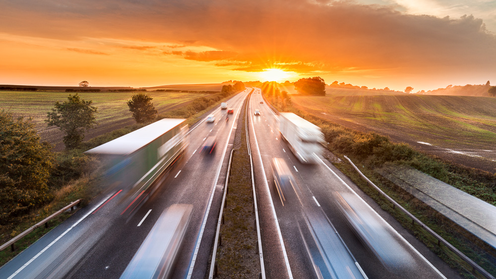 Image of Trucks on highway. New solution to capture CO2 from truck exhaust system involves liquefying it on vehicle's roof, finds study in Frontiers in Energy Research.