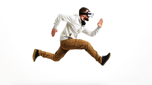 "Image of man running with virtual reality headset on. Researchers use virtual reality to show that people plan their movements and anticipate the force of gravity by ""seeing it"" through visual cues rather than ""feeling it"": Frontiers in Neuroscience"