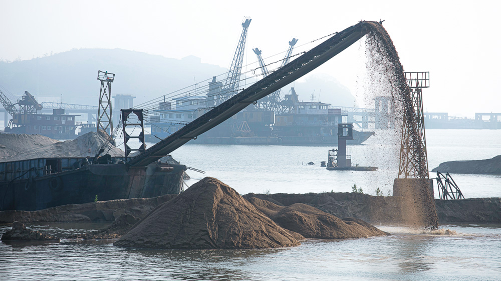 Image of dredgers doing coastal construction. A newly published study reports China's intertidal wetlands have suffered a loss of nearly 40% since the 1970s and calls for new legislation for their protection: Frontiers in Earth Science