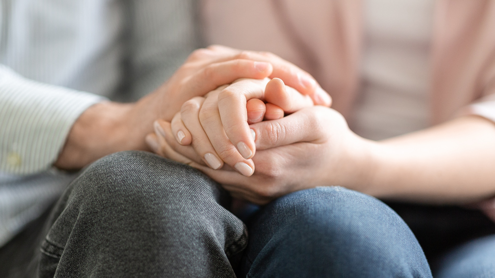 Image of two people holding hands. Findings may help health care professionals better assess those with autism, schizophrenia: Frontiers in Integrative Neurosciene