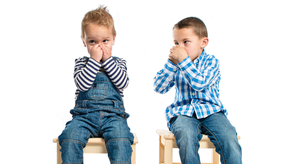 Image of two children covering their noses. Child body odor provides olfactory clues to parents about child's developmental stage: Frontiers in Psychology