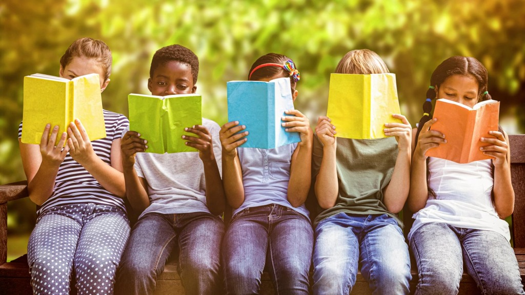 Image of children reading books: Study finds that children prefer storybooks that are rich in causal information, suggesting such books could help to increase their motivation to read: Frontiers in Psychology