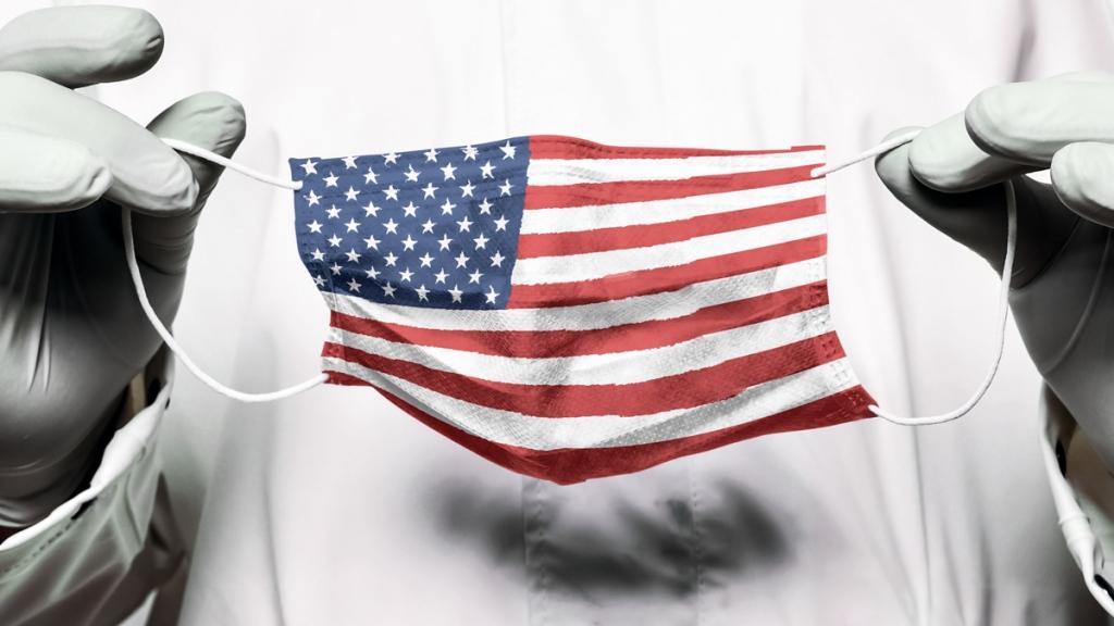 美国国旗的图象在facemask的。3月后,更加困难的县内的案例更加困难,而较差的地区的死亡率更高:社会学的边疆万博亚洲体育