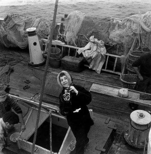 Anita Conti with photo camera on a fishing vessel.