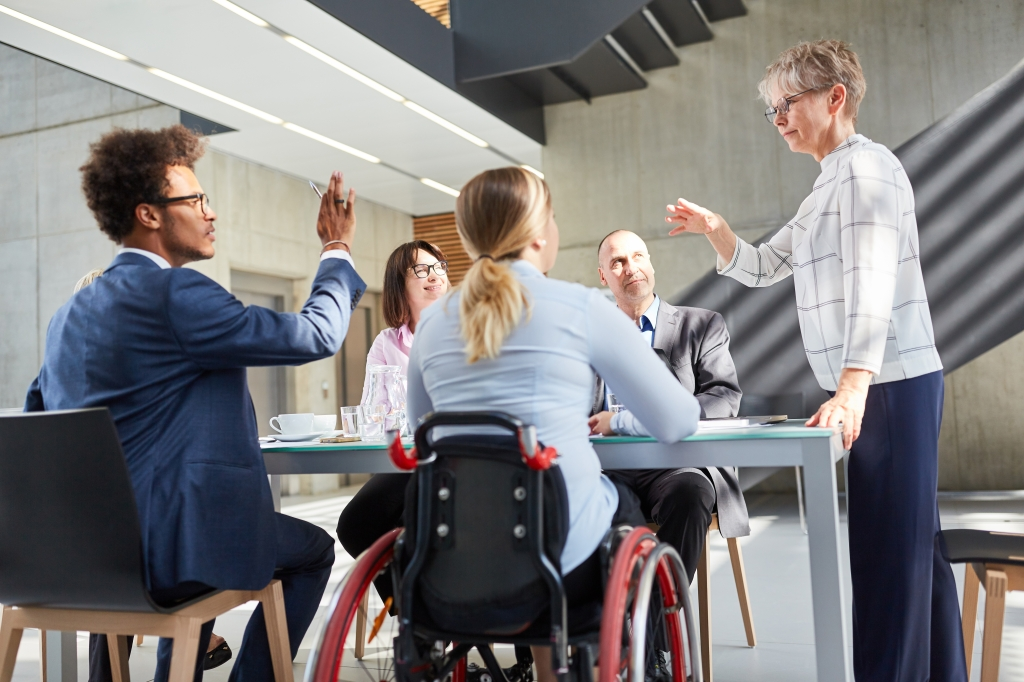 Image of a diverse group of people, including a person with a disability, talking. Voters perceive political candidates with a disability as capable, finds study in Frontiers in Political Science